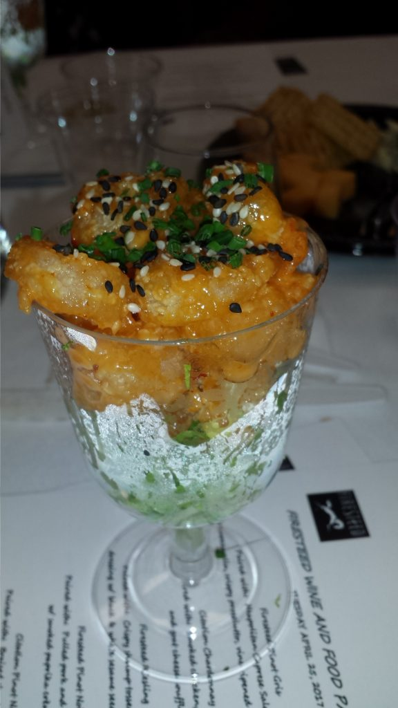 Crispy shrimp tossed in a sweet and spicy dressing with black and white sesame seeds and green onions