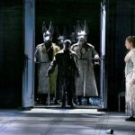 Photo of Walküre - Siegmund and Sieglinde falling in love, with Sieglinde's husband Hunding arriving home from the hunt.